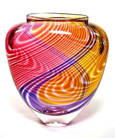 "Buzz Blodgett's U Pattern Cane Vase is an Outstanding and Unique Creation. The pattern of colored swirls pictured here is Magenta/Gold. It is signed and dated, Buzz Blodgett. It is available in Blue Multi-Color, Red Multi-Color and Lavender/Magenta. U Pattern Cane vase is approx. 10.5""h x 9.0""w x 4.5""d. Approximate weight is 11 lbs."
