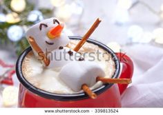 Red mug with hot chocolate with melted marshmallow snowman - stock photo