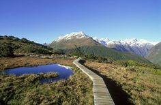 Blaze a trail past the snow-sprinkled mountains and yawning valleys of Fiordland National Park on New Zealand's Routeburn Track. Image by Grahame McConnell / Photolibrary / Getty Images