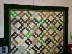 Easily manage any size quilt by machine quilting in sections.