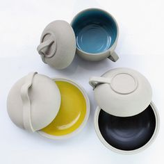 Shokti by Laurent Corio: Cooking vessels made of white clay with colore enamel interiors.
