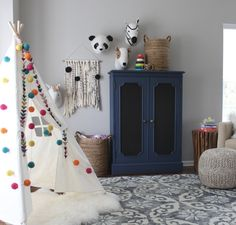 the redesign company, teepee, playroom, what happens when you paint an old, dark, wood cabinet navy blue!