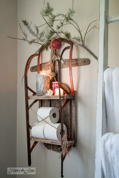 Christmas candles  / Snow sleigh toilet paper shelf on FunkyJunkInteriors.net #christmasjunkersunited