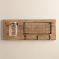 Ideal in the kitchen and compact spaces, our rustic, multipurpose wall storage features a mason jar ideal for displaying flowers, a wire basket for cutlery and three hooks for dishtowels, aprons and more.