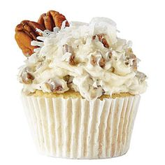 The Italian Cream Dream Cupcake - Vanilla Cupcake with Cream Cheese Frosting. ~> Stir 1 cup chopped toasted pecans and 1 cup sweetened flaked coconut into frosting. Garnish with sweetened flaked coconut and pecan halves.