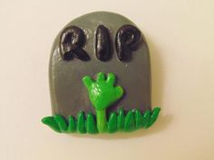 Handmade Zombie Rising from the Grave magnet available at yumjellydonuts.etsy.com  #handmade, #etsy, #sculpture, #magnet, #zombie, #RIP, #headstone, #gravestone, #tombstone, #grave, #risingfromthegrave, #georgeromero, #thewalkingdead, #spooky