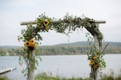 The couple exchanged vows in an outdoor ceremony under a sunflower-covered arch.