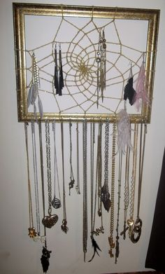 supereasy to make, just need an old frame, paint, yarn, glitter, and some nails, and the know how of how to make a dream catcher , looooove this, super proud