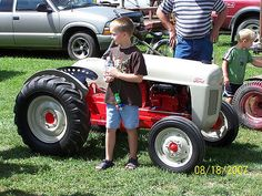 A scale model of a Ford tractor Photo by the Calime Family. Pedal Tractor, New Tractor, Tractor Mower, New Holland Tractor, Pedal Cars, Lawn Mower, John Deere Garden Tractors, Yard Tractors, Small Tractors