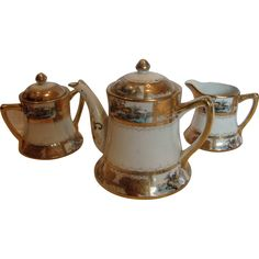 041516-2/RL-935 This is a Japanese Nippon hard paste porcelain tea set, consisting of a teapot, sugar and creamer.  The date is circa 1910. The teapot