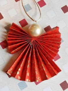 Christmas DIY: Origami Christmas An Origami Christmas Angel Decoration in Red an. Christmas DIY: Origami Christmas An Origami Christmas Angel Decoration in Red and Gold Christmas Angel Decorations, Paper Christmas Ornaments, Christmas Origami, Christmas Angels, Christmas Art, Christmas Projects, Christmas Ideas, Japanese Christmas, Crochet Ornaments