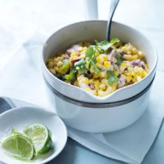 Michael Symon's delicious version of creamed corn has great bacon flavor, a little tang from sour cream and a bright kick from lime zest.