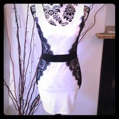 Body con dress Wet Seal white body con  stretch knit mini dress with sexy black lace overlay. Some loose threads around neckline, not noticeable without close inspection. Otherwise, dress is in good condition.  REASONABLE OFFERS WELCOME !!😀 Wet Seal Dresses