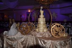 A fairytale wedding with a happily ever after.. Cinderella Carriage and cake. Event provided by Kim's Bridal