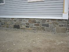Stone veneer siding.