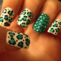 I'm thinking of getting these done for St. Patricks Day! Minus the ghetto bling nail