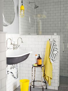 A more modern feel to your bathroom design. Choose classic white subway tiles with black and yellow accents for a cool bathroom decor. Bathroom Color Schemes, Bathroom Colors, Bathroom Ideas, Bathroom Layout, Bathroom Styling, Bathroom Designs, Bathroom Storage, Yellow Bathrooms, White Bathroom
