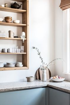 Old Project, Fresh New Update - Avenue Lifestyle / terrazzo countertops and light wood wall shelves in kitchen Modern Kitchen Cabinets, Kitchen Shelves, Kitchen Interior, Kitchen Walls, Interior Desing, Interior Decorating, Recessed Shelves, Open Shelving, Kitchen Remodel Cost