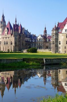 Moszna Castle in morning light, Poland [Moszna Castle, Poland The Moszna Castle, before 1945 German: Schloss Moschen) is a historic castle and residence located in a small village of Moszna in Poland. The castle is one of the best known monuments in the western part of Upper Silesia. The history of this building begins in the 17th century, although much older cellars were found in the gardens during excavations carried out at the beginning of the 20th century]