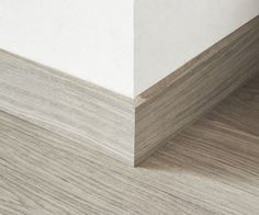Quick-Step Largo Parquet Skirting 14 x 100 x Design skirting board has been specifically designed to complement the long and wide planks of the Quick-Step Largo laminate floors. The back of this skirting board contains a groove to hide p Baseboard Styles, Baseboard Trim, Baseboards, Floor Skirting, Skirting Boards, Wood Parquet, Parquet Flooring, Kitchen Flooring, Wood