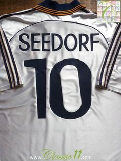 ee358576e57 Relive Clarence Seedorf s 1998 1999 season with this vintage Adidas Real  Madrid home football shirt