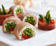 Prosciutto Sushi Rolls - Roll up asparagus and roasted red pepper with goat cheese and walnut for a creamy holiday appetizer.