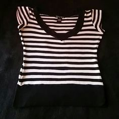 Short sleeve V neck tee Black and white striped v-neck short sleeve tee,size is a small 97% rayon 3% spandex, used in good condition Tops Tees - Short Sleeve