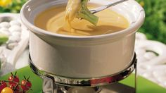 Want a different party dip for veggies? Try a warm cheesy fondue.