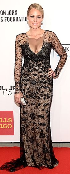 Jewel looked elegant in a black lace gown featuring a plunging neckline. She paired the chic look with a sparkling clutch.