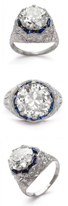 Lady's Art Deco diamond & platinum engagement ring, featuring a center mine-cut diamond, about 4.25 cts., in a platinum filigree setting, framed with sapphires and accented with diamond chips; 5.4 grams