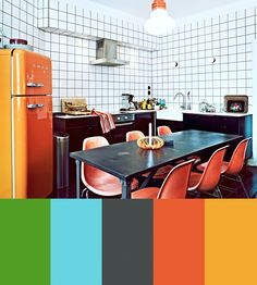 Scandinavian interior with modern elements and rich colors. No chance of getting depressed in the dark of winter.  And I want an orange fridge a la 80ies!