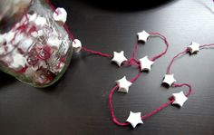 paper stars. i used to make these all the time. you were supposed to write wishes in them.  never thought to make garland! cute