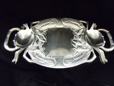 Crab Platter with Handles $34.99 Words cannot describe the beauty of this elegant crab bowl. A unique shrimp design is featured around the rim of this lovely bowl!! The uses are endless and the price unbelievable. Definitely a cart dropper. Hand wash only. www.CharlestonGiftsOnline.com