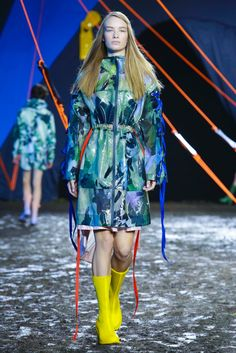 Brightly colored waterproof rubber and vinyl jackets at the Hunter Original spring/summer 2016 show during London Fashion Week. (Photo: Nowfashion.com)