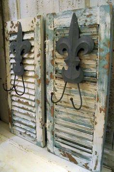 French blue wood shutters fleur de lis hooks