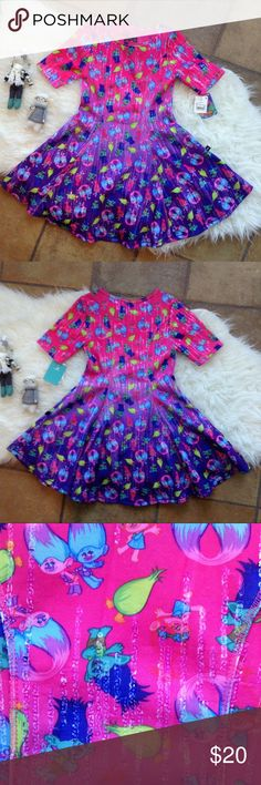 Trolls Ombré Pink and Purple Dress This adorable Trolls dress is just too much fun! Fades from purple to pink and has clear sequins throughout. Size medium (7-8). In beautiful condition. Dresses