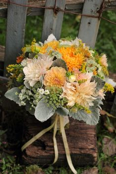 October with dahlias and antique mums... Classiest version of a fall themed bouquet i've seen so far.