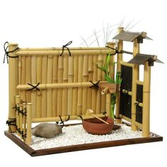 """Zen Bamboo Mini Rock Garden / 19.5""""W x 14""""D x 18""""H Indoor personal rock garden, crafted using genuine bleached and dark stained bamboo rods. Walnut stained, mitered wood frame holds light pebbles and larger stone. Bamboo and wood faux-fountain and clay bowl. Perfectly replicates traditional Zen rock gardens. Small enough to place on an accent table or chest; large enough to bring the peace and tranquility of a Zen garden into the home or office. Details: Personal indoor Zen rock garden Crafted w Zen Rock Garden, Mini Zen Garden, Garden Modern, Indoor Zen Garden, Gravel Garden, Modern Backyard, Garden Stones, Water Garden, Miniature Zen Garden"""