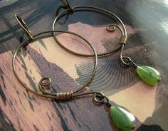 1.5 x 2.75 inch swirly gunmetal hoops with jade drops dangle from brass lever backs.