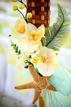 yellow plumeria wedding flowers, starfish, aqua sash