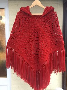 Handmade crochet hooded poncho with fringe and by woollythings Sie Poncho Hippie Handmade crochet hooded poncho with fringe and tassel in fabulous red. Seventies retro/vintage style poncho brought up to date with a hood Point Granny Au Crochet, Granny Square Poncho, Cardigan Au Crochet, Crochet Poncho Patterns, Knitted Poncho, Crochet Shawl, Granny Squares, Hooded Poncho Pattern, Knitting Patterns
