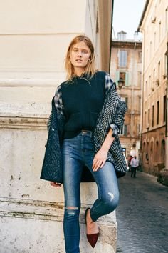 """madewell 9"""" high riser skinny skinny jeans in bristol wash, merino ribbed sweater-vest, oversized boyshirt in andover plaid, herringbone wrap jacket + the lydia flat worn by our muse constance jablonski in our fall catalog shot in rome. #everydaymadewell to pre-order, call 866-544-1037."""