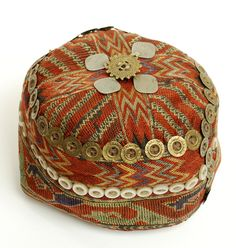 A vintage Pashtun tribal hat from the Swat valley in Pakistan's northern area. Hand embroidered cotton with buttons and bronze ornamentation...