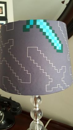 MineCraft Lamp Shade. New Lamp Shade made in Minecraft. Color is Gray Shade size is 8x10x7. That is 8 top diameter, 10 bottom diameter and 7 height. Perfect for nursery, desk or bedroom.