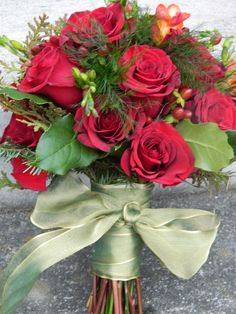 Christmas wedding bouquet by www.petalsfloraldesignvt.com