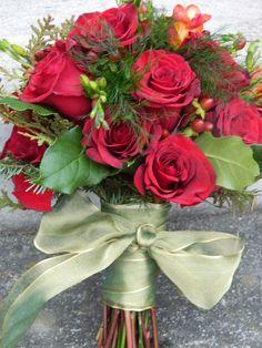 Christmas wedding bouquet by www.petalsfloraldesignvt.com