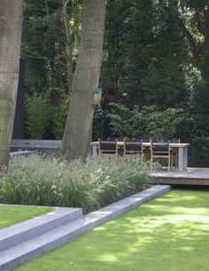 Luxe tuin ontwerp met zithoek en diverse hoogteniveaus