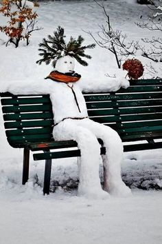 UNIQUE snow man sitting on a park bench - shaped like a man instead of round with a wreath or mistletoe on his head.