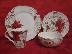 Wish this was a teacup and saucer instead of a mug.  Such pretty plates!  222 FIFTH WINTER HARMONY RED POINSETTIA HOLIDAY CHRISTMAS 24PC DINNERWARE SERV 6