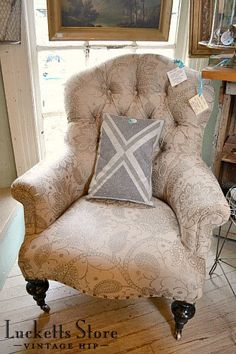 A chair upholstered in Ethan Allen fabric